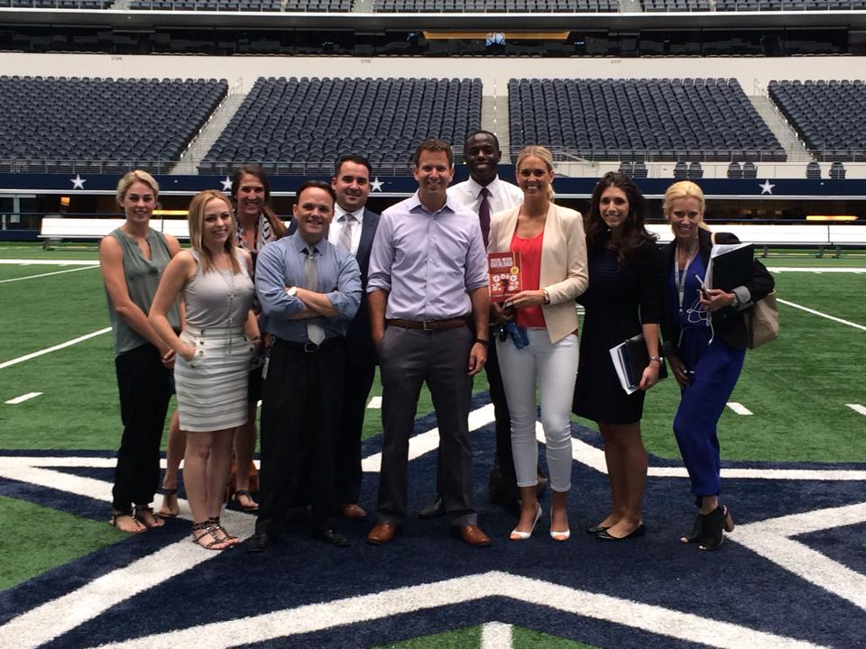 Corey consulting with the Dallas Cowboys Sales team